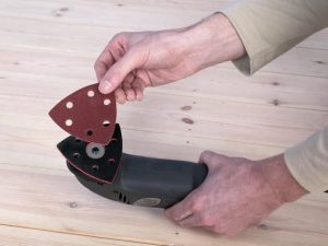 corner sander set up man fitting sandpaper
